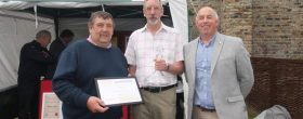 PGG Chairman Tony Arnold presented Stephen Butler (centre) with a PGG loyal service award .