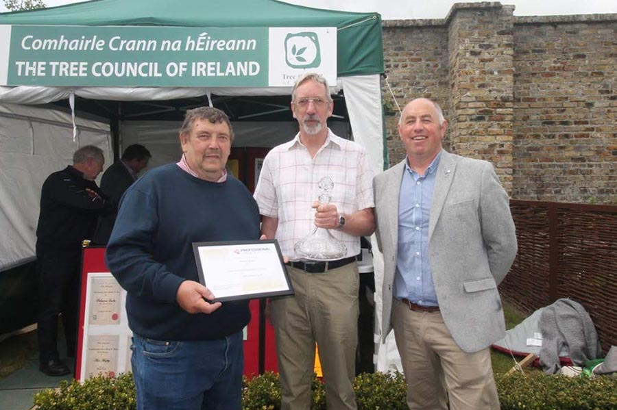 PGG Chairman Tony Arnold presented Stephen Butler (centre) with a PGG loyal service award .