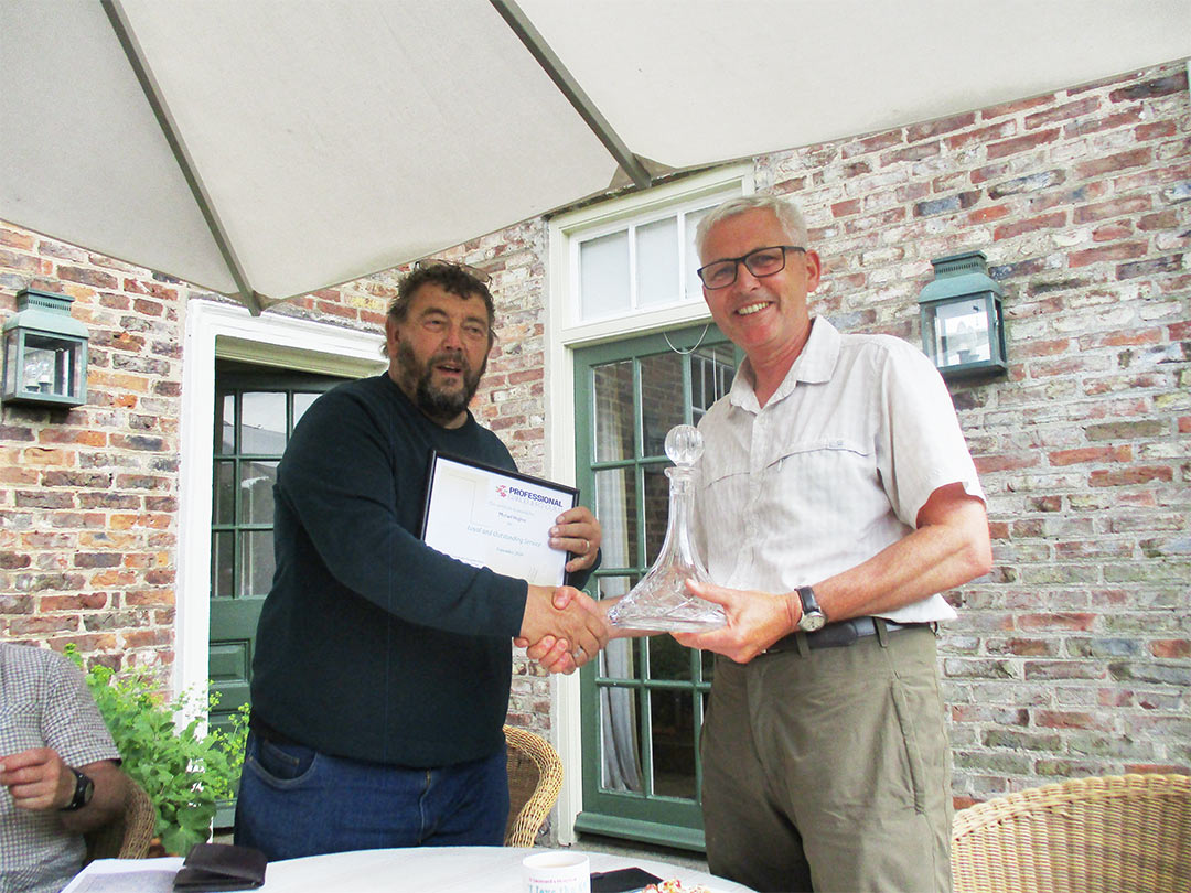 Tony Arnold, PGG Chairman, presentsMichael Hughes of Durham University Botanical Garden with Guild Loyal Service Award at Skipwith Hall, Yorkshire on 11.6.21.